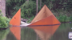 A desck structure with an orange pointed hide mounted on it